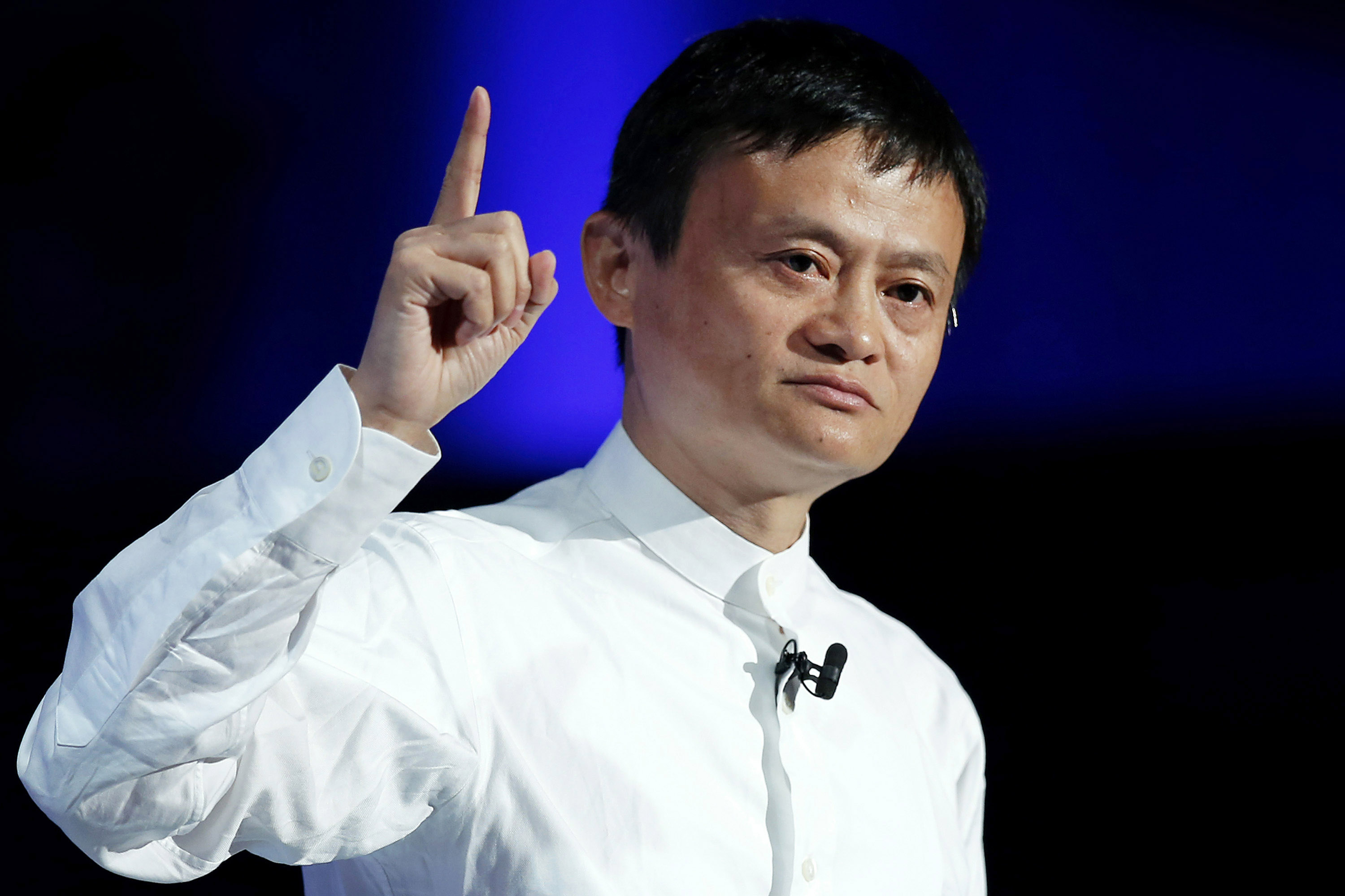 Jack Ma, chairman of Alibaba Group Holding Ltd., gestures as he speaks at SoftBank World 2014 in Tokyo, Japan, on Tuesday, July 15, 2014. As Softbank Corp.  Chief Executive Officer Masayoshi Son pushes for a Takeover of T-Mobile US Inc., the Japanese Billionaire is asking banks to commit financing for a longer-than-usual amount of time, underscoring the intense regulatory review he faces.  Photographer: Kiyoshi Ota / Bloomberg *** Local Caption *** Jack Ma