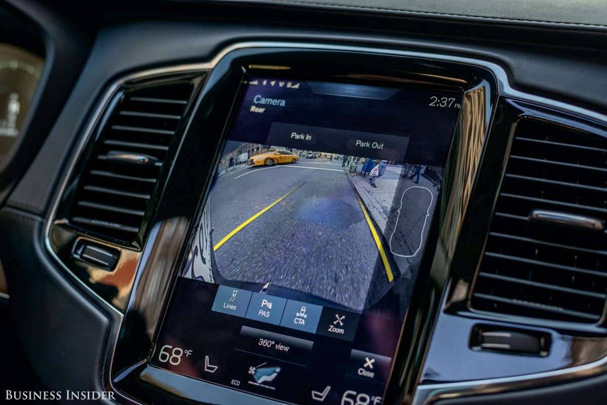 The center console is dominated by a massive, Tesla-style vertical touchscreen. To toggle between the various menus on the infotainment system, you can swipe left and right, as on an iPad.