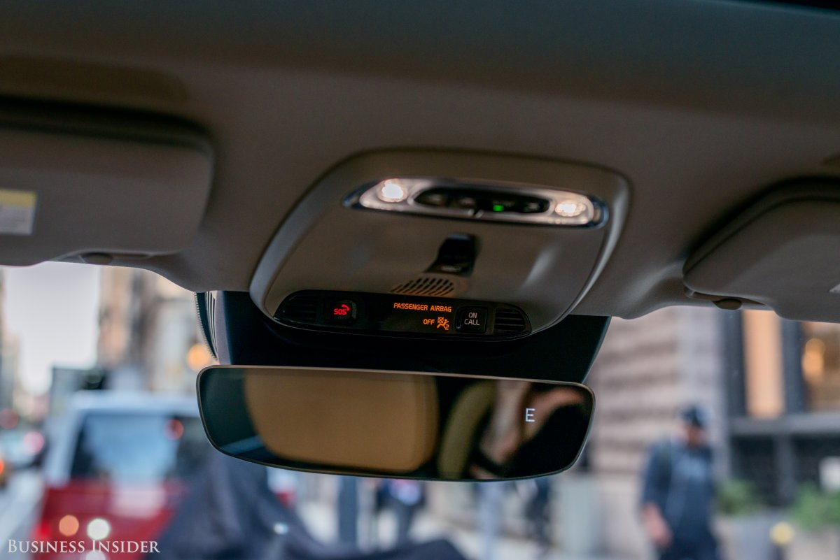 Toggle the switch mounted near the rearview mirror and ...