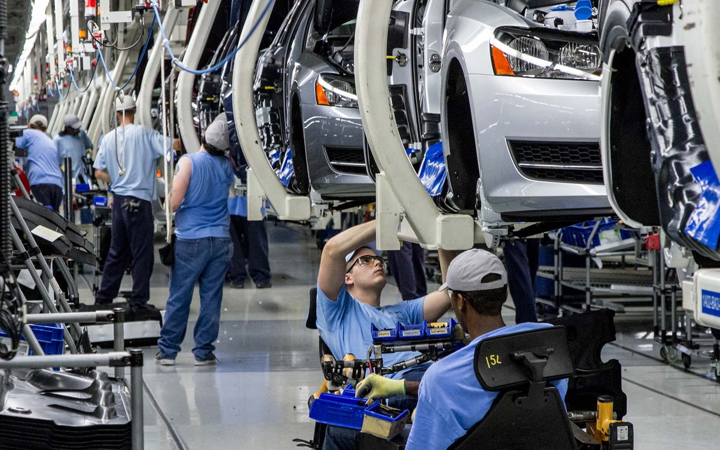 FILE - In this June 12, 2013, file photo, workers assemble Volkswagen Passat sedans at the German automaker's plant in Chattanooga, Tenn. Workers at the plant will decide in a three-day vote Wednesday, Feb. 12, 2014, whether they want to be represented by the United Auto Workers union. (AP Photo/Erik Schelzig, file)