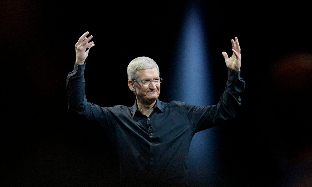 Apple CEO Tim Cook gestures while speaking at the Apple Worldwide Developers Conference in San Francisco, Monday, June 2, 2014. Apple's Mac operating system is getting a new design and better ways to exchange files, while new features in the software for iPhones and iPads include one for keeping tabs on your health. (AP Photo/Jeff Chiu)