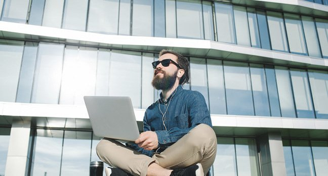 hipster_with_laptop_photo_via_shutterstock