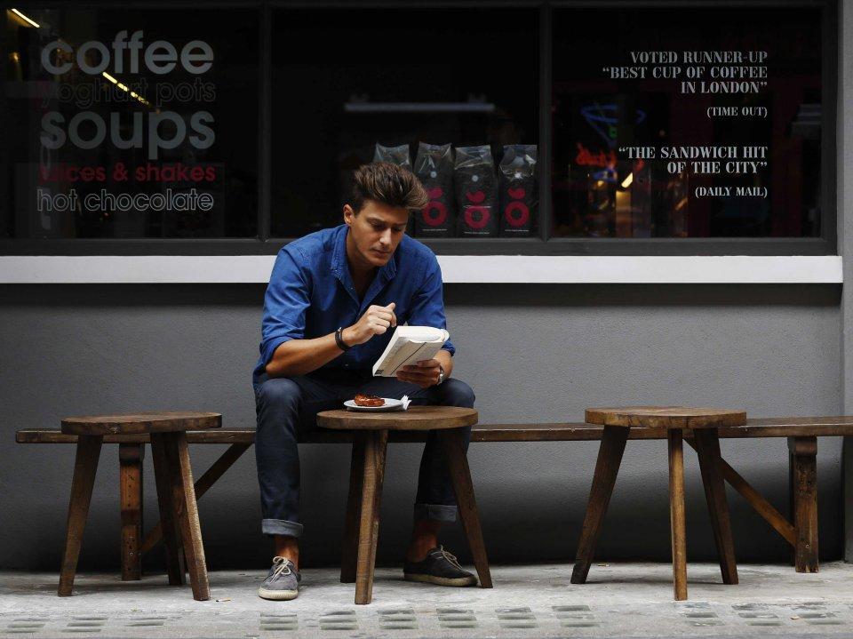 man-reading-book-london