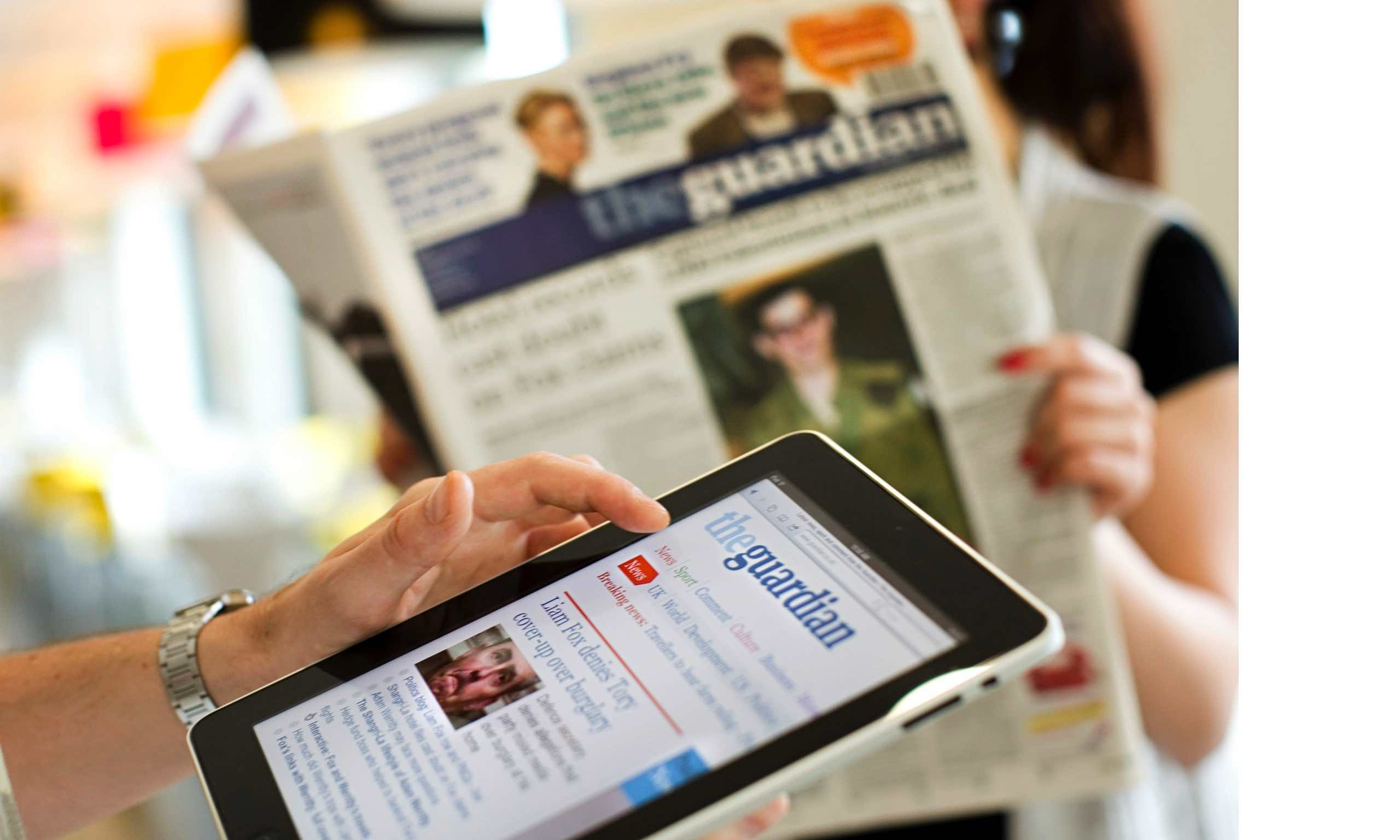 The Guardian newspaper in print on and on ipad.