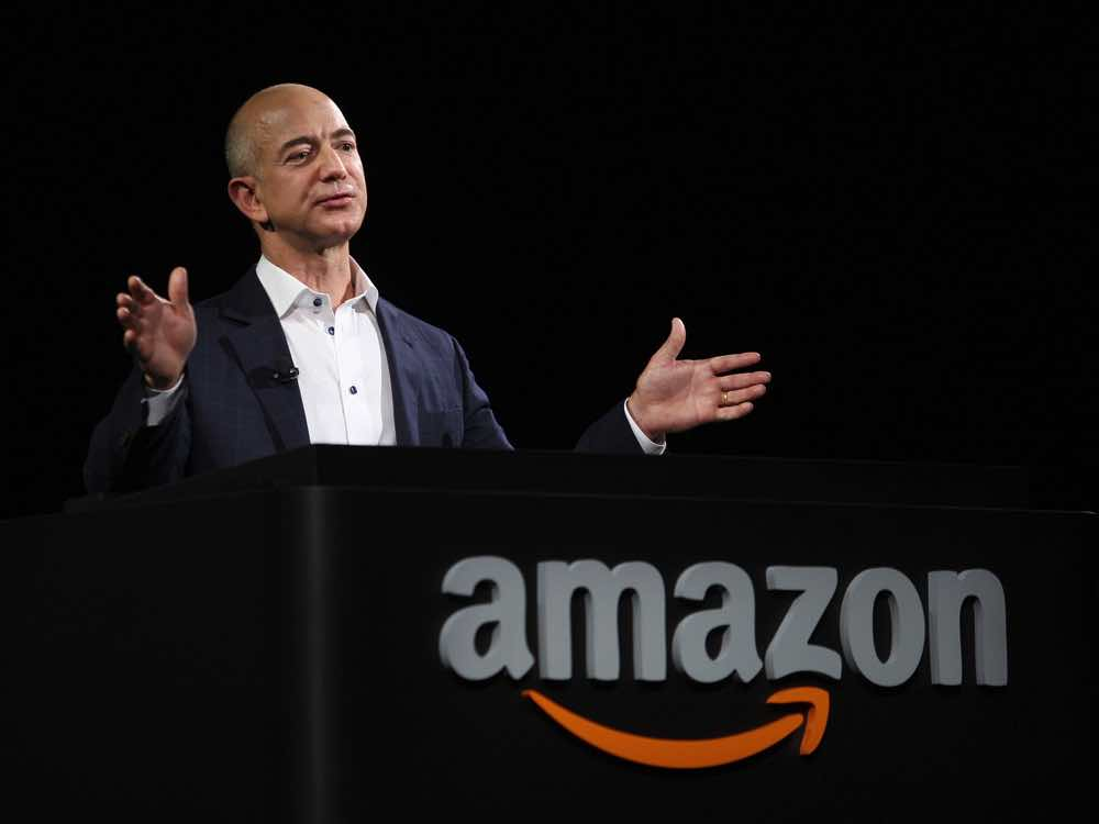 SANTA MONICA, CA - SEPTEMBER 6: Amazon CEO Jeff Bezos unveils new Kindle reading devices at a press conference on September 6, 2012 in Santa Monica, California. Amazon unveiled the Kindle Paperwhite and the Kindle Fire HD in 7 and 8.9-inch sizes. (Photo by David McNew/Getty Images)