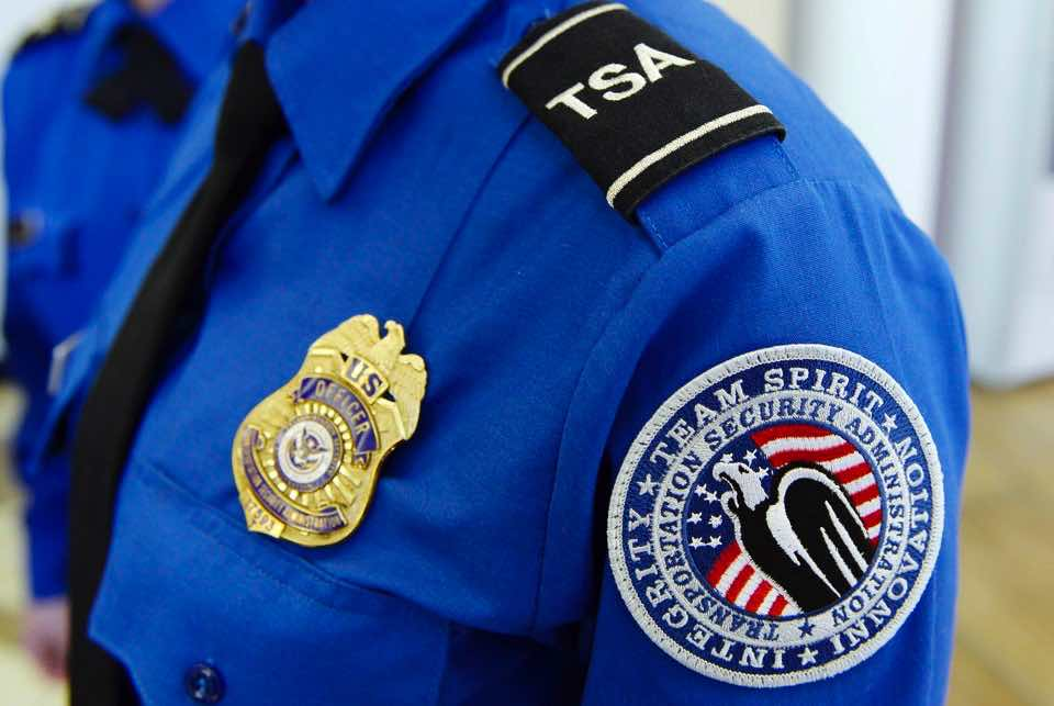 A Transportation Security Administration (TSA) arm patch and shield is seen at Los Angeles International Airport, California February 20, 2014. U.S. authorities issued a warning on Wednesday to airlines flying to the United States to watch out for militants who may have hidden bombs in their shoes, U.S. government sources said. iREUTERS/Kevork Djansezian (UNITED STATES - Tags: POLITICS SOCIETY TRANSPORT) - RTX197YF