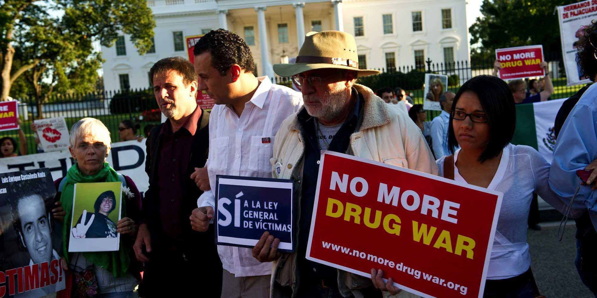 "Protestors chant march in front of the White House in Washington on September 10, 2012 during the ""Caravan for Peace,"" across the United States, a month-long campaign to protest the brutal drug war in Mexico and the US. The caravan departed from Tijuana in August with about 250 participants and ended in Washington. AFP PHOTO/Nicholas KAMM (Photo credit should read NICHOLAS KAMM/AFP/GettyImages)"