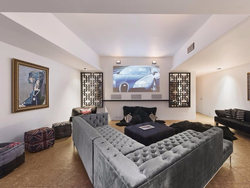 the-whole-place-seems-to-be-rocking-a-bachelor-pad-vibe-this-media-room-was-bathed-in-an-eerie-green-light-prior-to-the-most-recent-renovation