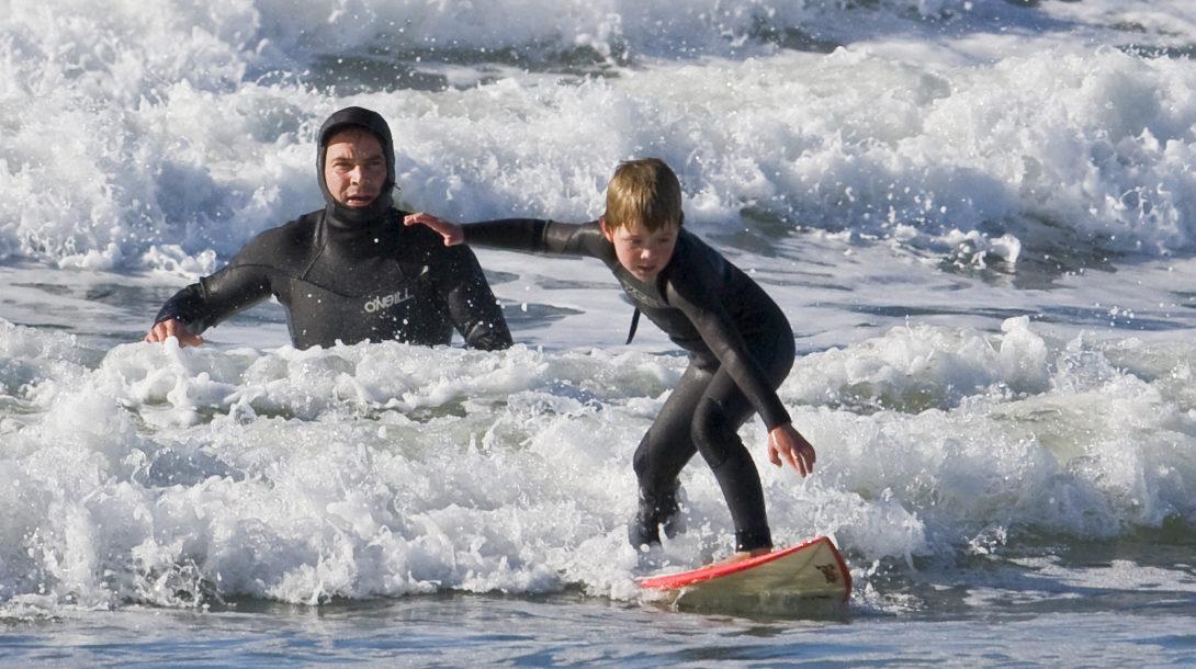 Father and son surf lesson in Morro Bay, CA
