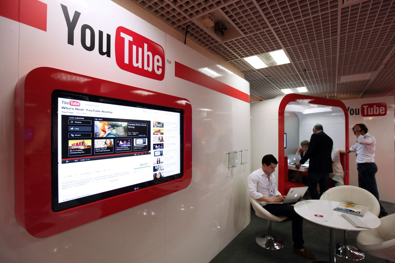 "People visit the ""You Tube"" stand on October 3, 2011 in Cannes, southern France, during the international MIPCOM audiovisual trade show. AFP PHOTO SEBASTIEN NOGIER (Photo credit should read SEBASTIEN NOGIER/AFP/Getty Images)"