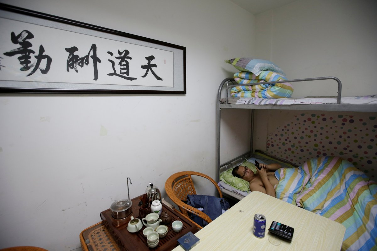 dormitories-like-this-one-are-provided-in-the-doumiyoupin-office-here-an-it-engineer-rests-after-finishing-work-at-midnight-according-to-reuters-the-writing-on-the-wall-translates-to-god-rewards