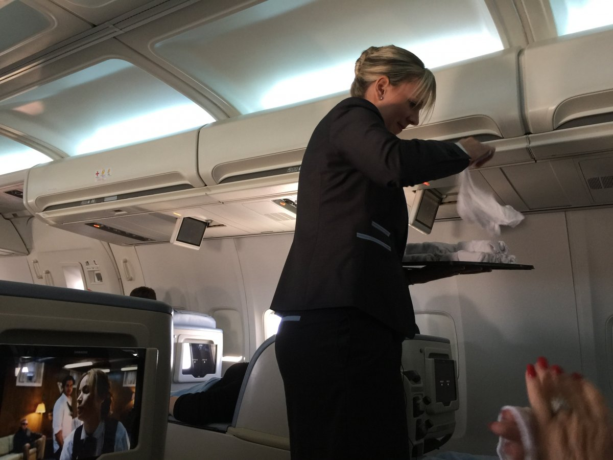 just-after-take-off-the-flight-attendants-came-around-with-hot-towels