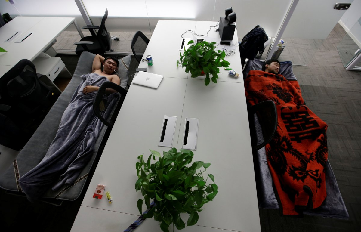 some-employees-at-renren-credit-management-co-sleep-on-provided-camp-beds-in-their-office
