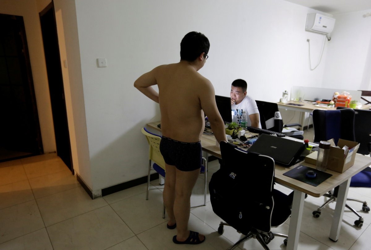 some-offices-are-run-out-of-apartments-such-as-n-wei-beijing-technology-co-ltd-here-a-programmer-chats-with-his-colleague-before-he-heads-off-to-bed