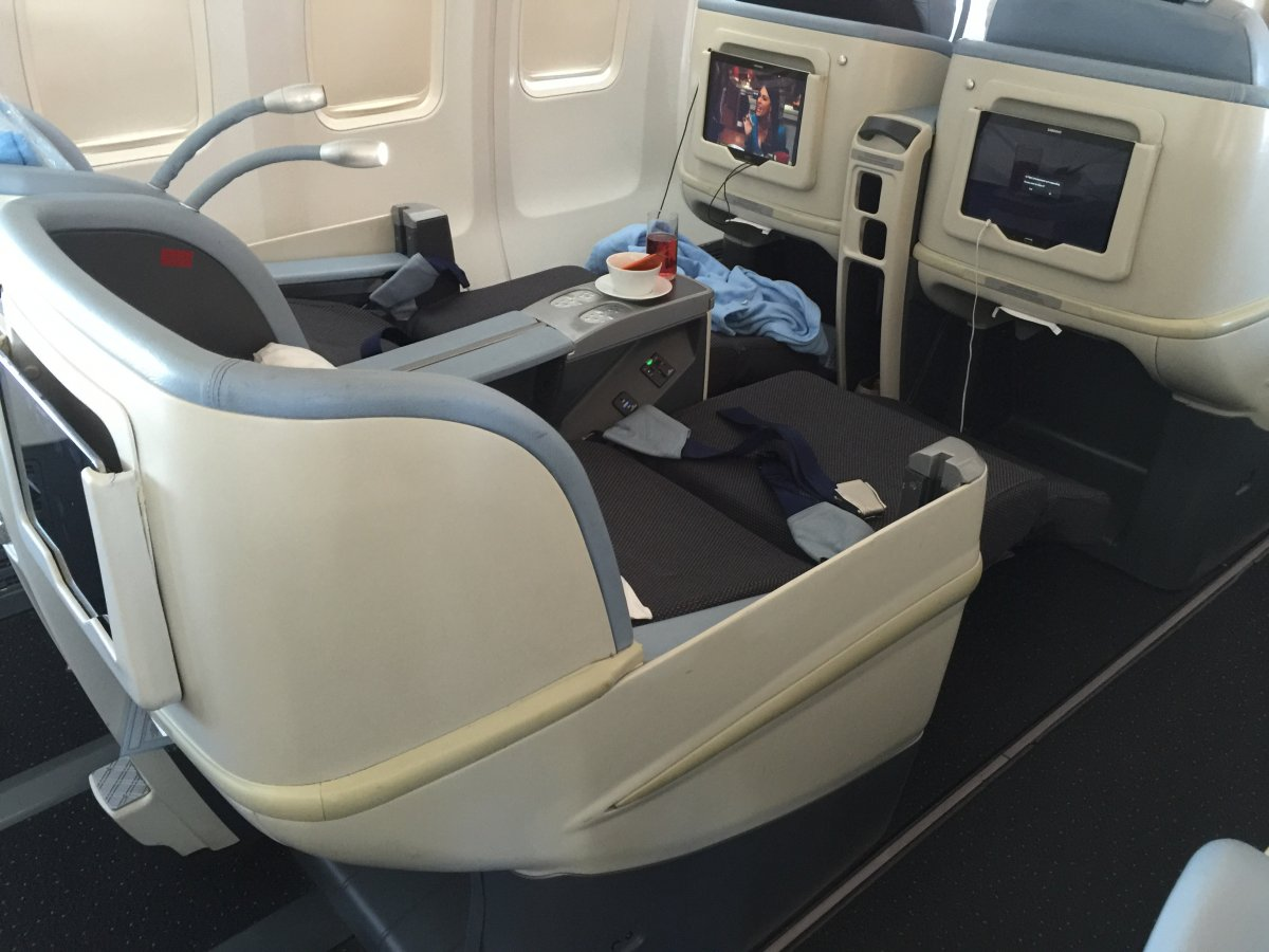 the-seats-are-spacious-and-comfortable-they-recline-to-a-175-degree-angle-and-have-a-built-in-massage-feature-which-i-took-full-advantage-of