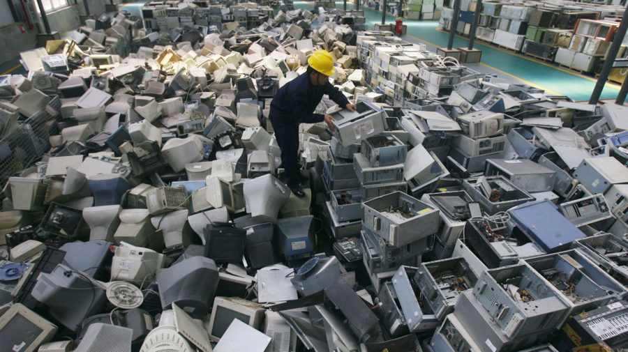 An employee arranges discarded computers at a newly opened electronic waste recycling factory in Wuhan