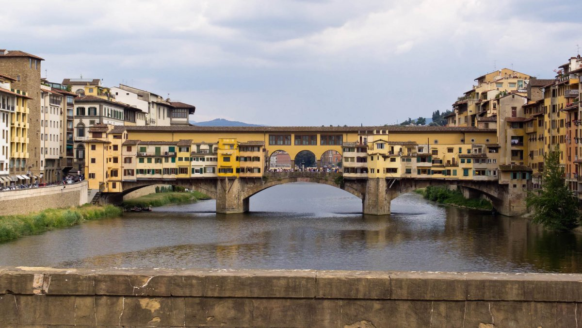 36-the-shops-nestled-into-the-ponte-vecchio-arch-bridge-in-florence-italy-were-once-home-to-butchers-shops-but-are-now-occupied-by-souvenir-sellers