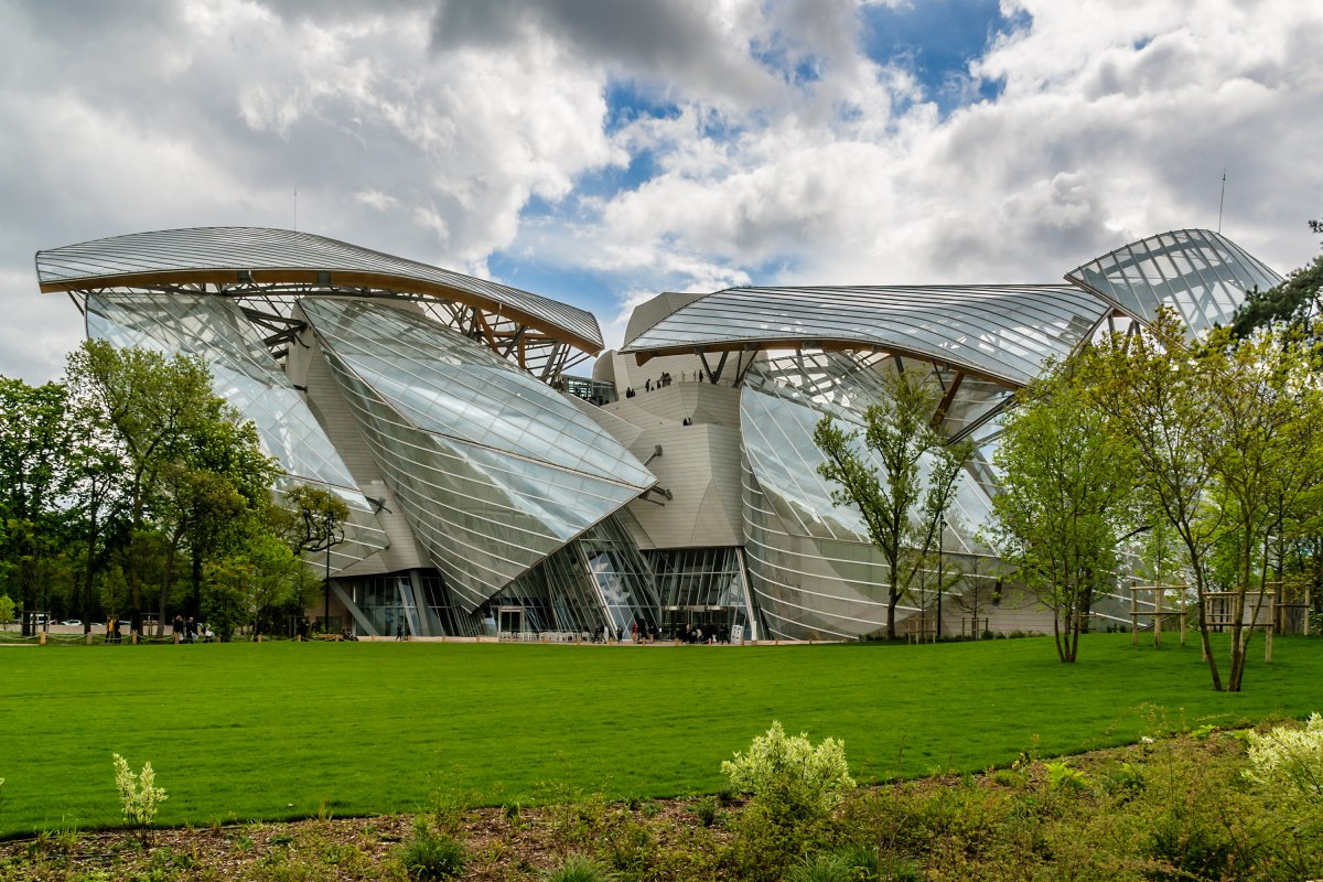 54-the-louis-vuitton-foundation-is-a-mesh-of-glass-sails-nestled-in-the-bois-de-boulogne-park-in-paris