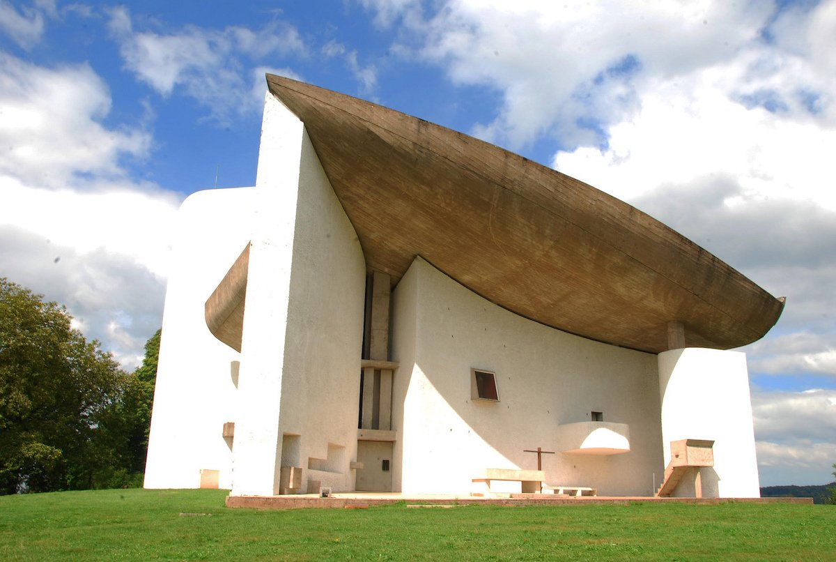 57-le-corbusiers-chapelle-la-notre-dame-du-haut-a-tiny-chapel-near-the-french-town-of-ronchamp-is-a-bold-20th-century-masterpiece