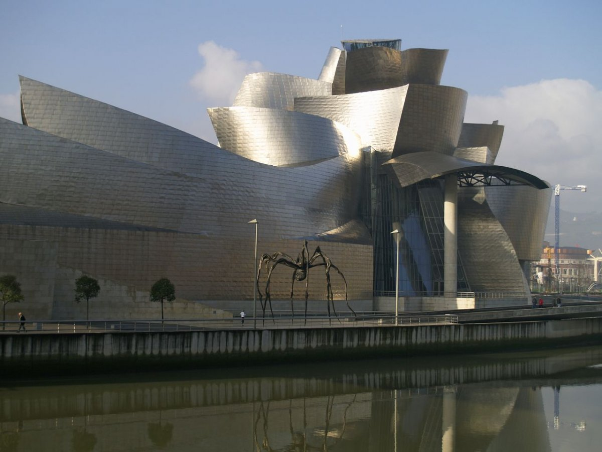 65-made-out-of-glass-limestone-and-titanium-frank-gehrys-guggenheim-bilbao-in-spain-shimmers-in-the-sunlight