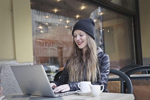 Girl-Blogger.-Blogging-with-Laptop