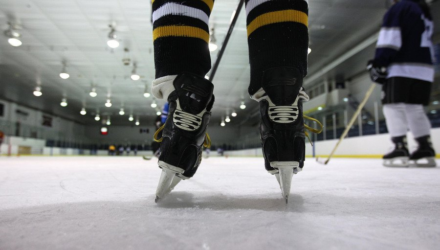 """Some of the players were a little wobbly ankles as a group of hockey moms in their 30s and 40s are taking up hockey for the first time. Until just a few weeks ago, many had never skated on hockey skates, now they're out in full equipment learning the game from a couple of young guys who call them """"girls."""" at the Leaside Memorial Gardens in Toronto. March 9, 2011 STEVE RUSSELL/TORONTO STAR"""