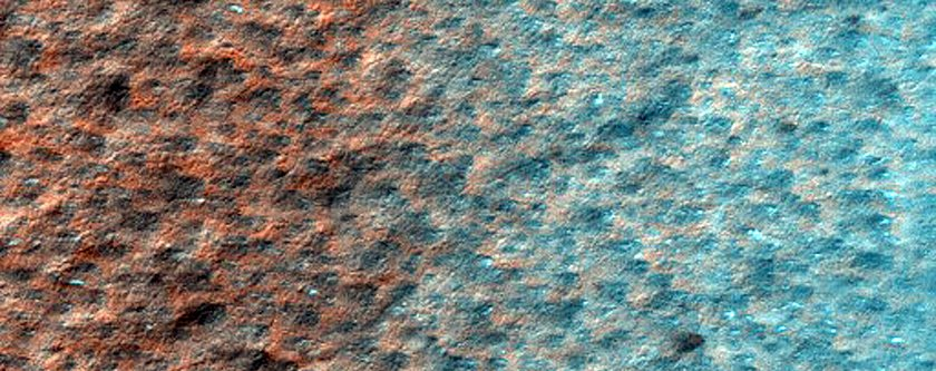 an-icy-patch-at-mars-south-pole-thats-littered-with-dark-spots