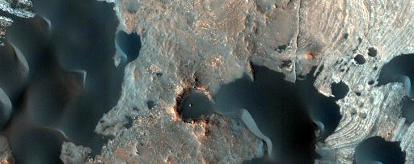 blowing-sand-eats-through-the-rims-of-older-craters-1