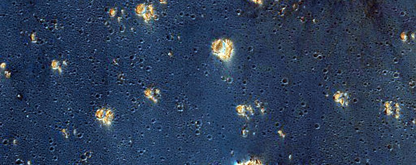 false-colors-assigned-to-certain-minerals-make-syria-planum-an-inky-blue-thats-speckled-with-gold
