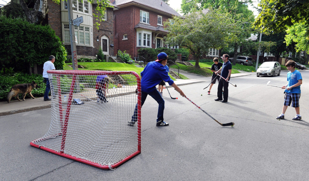 Boys from theYonge Eglinton Neighbourhood mix it up with a little street hockey. The city is under pressure to drop the city wide ban on street hockey and Trustee Josh Matlow is heavily involved.Matlow in the middle of the street with boys as a car approaches..(June15 2010 )Rick Eglinton/Toronto Star.