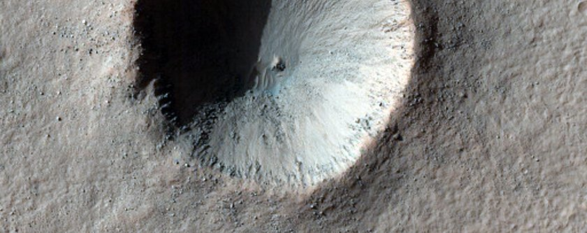 this-crater-near-a-region-called-aonia-terra-looks-like-part-of-the-death-star