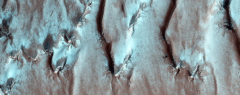 this-is-the-edge-of-a-special-layered-deposit-at-mars-south-pole-the-false-color-makes-the-white-look-like-ice-but-its-just-one-of-the-many-layers-of-rock-and-soil-1