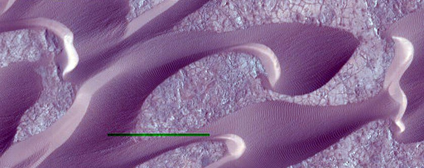 wind-shaped-dunes-on-mars-crawl-across-cracked-soil-in-nili-patera-the-green-bar-is-leftover-from-processing-the-image