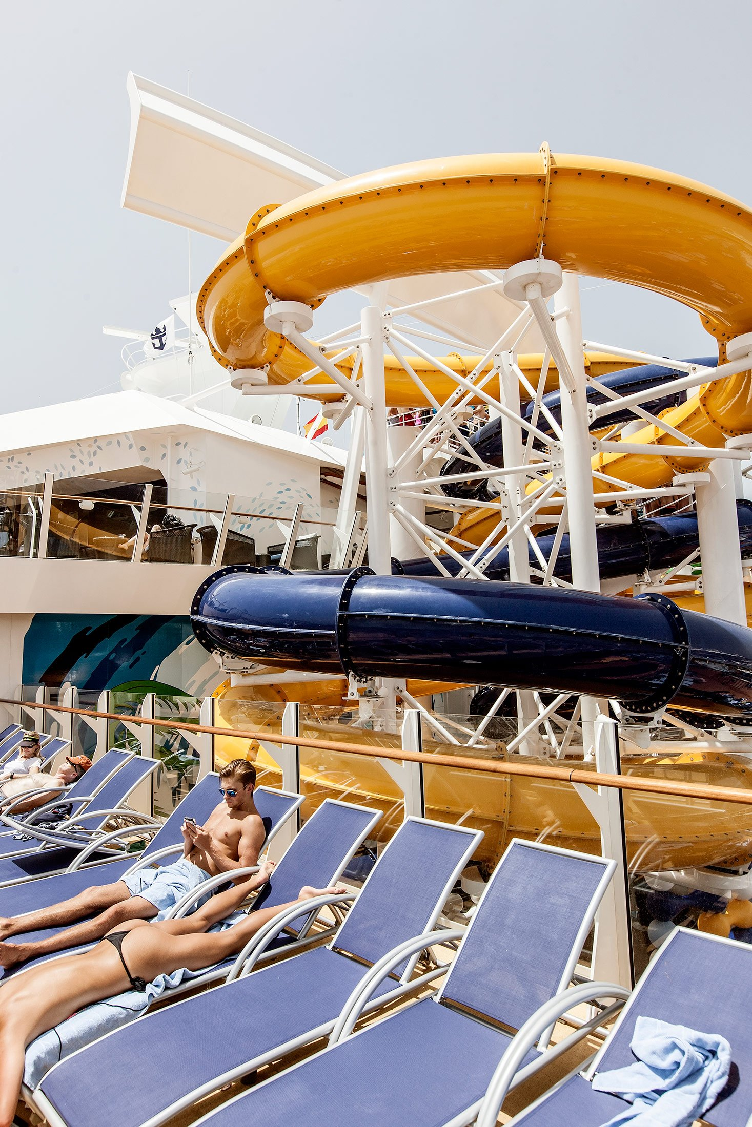 Royal Caribbean, Harmony of the Seas, Stretching the length of the ship, the Pool and Sports Zone is an ample playground for guests of all ages, featuring four unique types of pools, two FlowRider surf simulators, a zip line, amazing views of Boardwalk and Central Park below, plus the introduction of a trio of water slides as well as the Ultimate Abyss. plus bars and afternoon lice concerts The Perfect Storm– spiraling five decks above the landscaped, open-air Central Park in the center of the ship, waterslides Cyclone, Typhoon and Supercell come together as The Perfect Storm. Guests can challenge each other and race to the finish line with Cyclone and Typhoon, which twist and turn down three decks, while sliders in Supercell will be swirled around its unique champagne bowl before descending into a big splash finale.