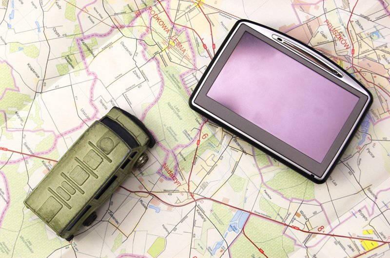 GPS - global positioning system and car on map