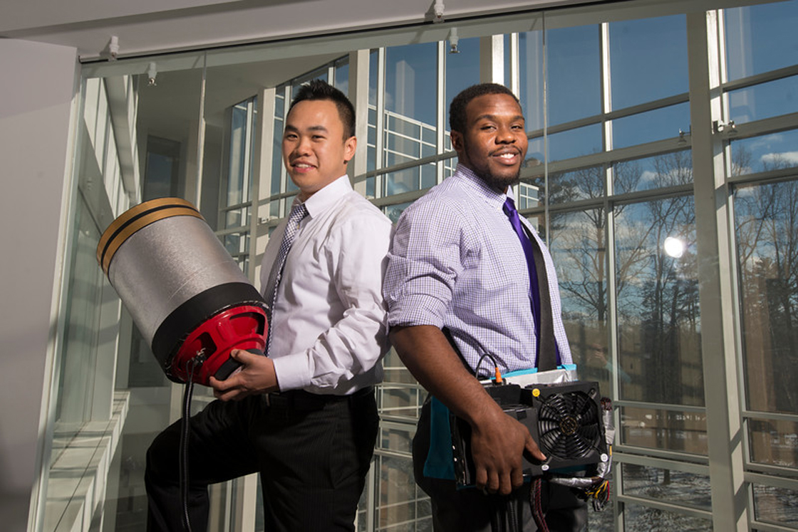 """""""Students Viet Tran (L) and Seth Robertson with their invention, a sound extinguisher, at the Fairfax Campus. Photo by Alexis Glenn/Creative Services/George Mason University"""""""