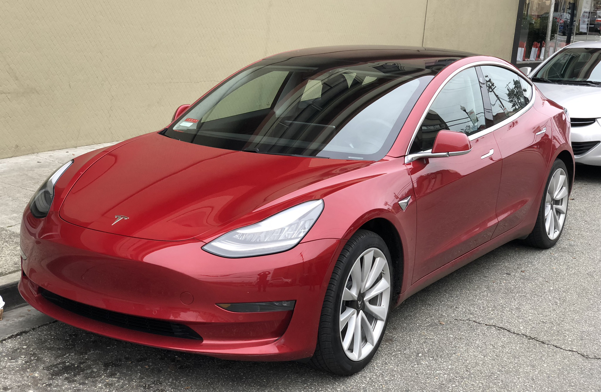 tesla_model_3_parked_front_driver_side