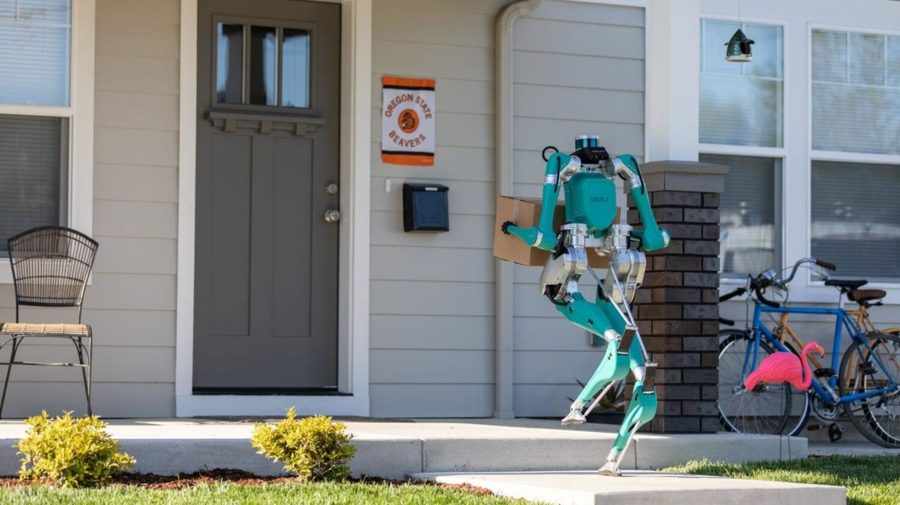Robot Digit ako kuriér, ktorý prináša balík. Agility Robotics